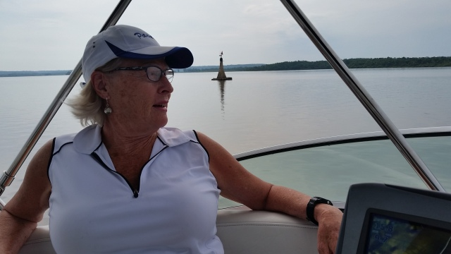 Joan on bridge with mini lighthouse.jpg